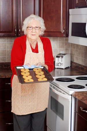 Senior woman with fresh baked cookies