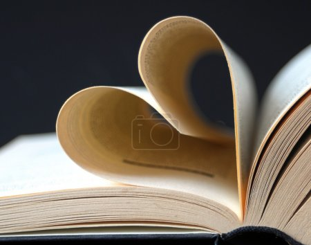 Pages of a book curved into a heart