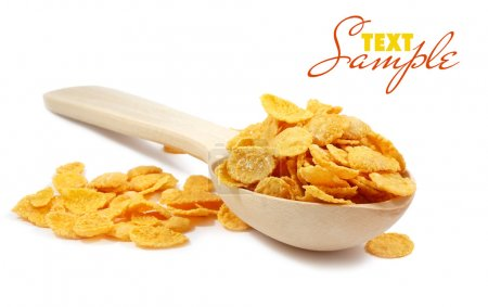 Photo for Corn flakes and wooden spoon isolated on white - Royalty Free Image