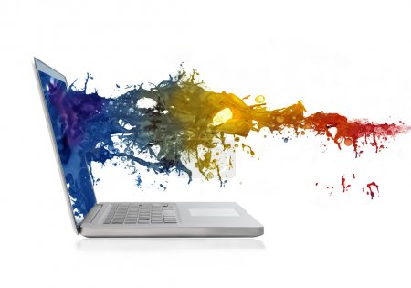 Photo for Wave of colored paint splashing out from a laptop screen - Royalty Free Image
