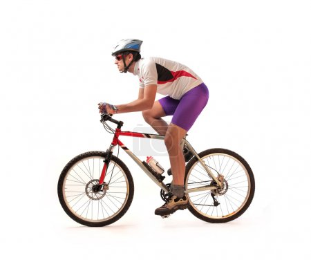 Photo for Portrait of a cyclist riding his bike - Royalty Free Image