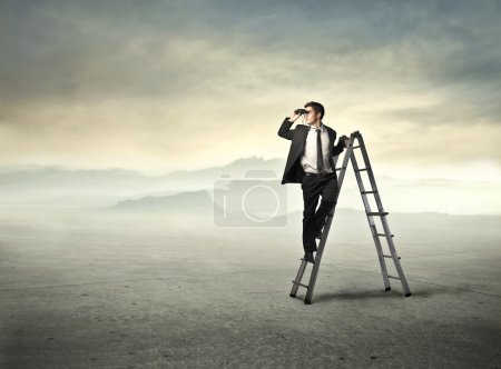 Photo for Businessman standing on a ladder and using binoculars - Royalty Free Image