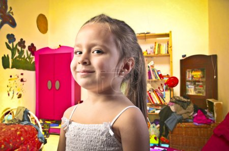 Photo for Smiling little girl in her bedroom - Royalty Free Image