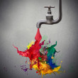 Tap pouring colored paint...