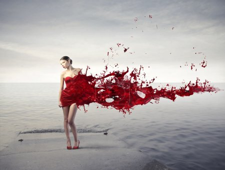 Photo for Beautiful woman with her dress melting in red paint - Royalty Free Image