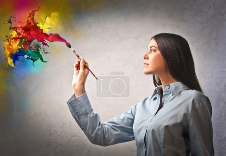 Photo for Beautiful woman painting with different colors - Royalty Free Image