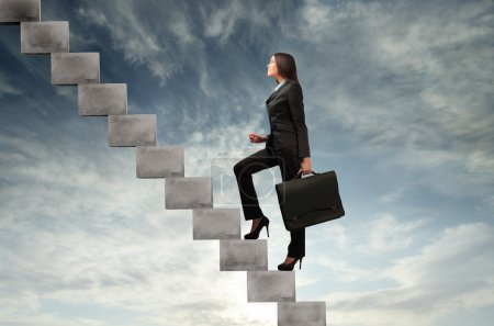 Photo for Businesswoman stepping up a stairway - Royalty Free Image