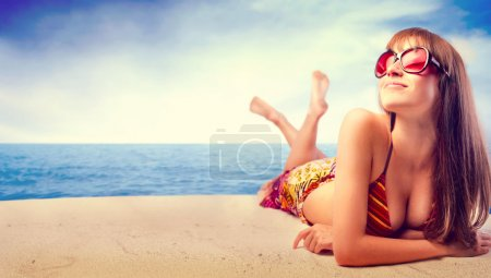 Photo for Smiling beautiful woman sunbathing at the seaside - Royalty Free Image
