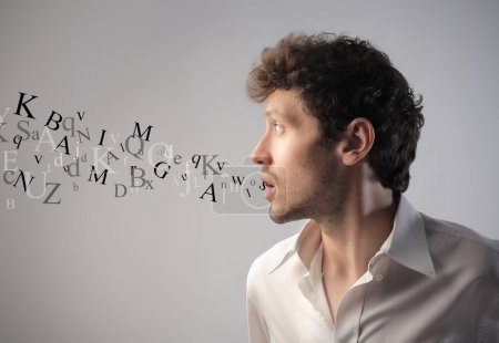 Photo for Young man talking and alphabet letters coming out of his mouth - Royalty Free Image