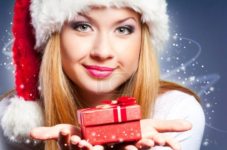 Photo for Beautiful woman in the Santa Claus hat with gift - Royalty Free Image