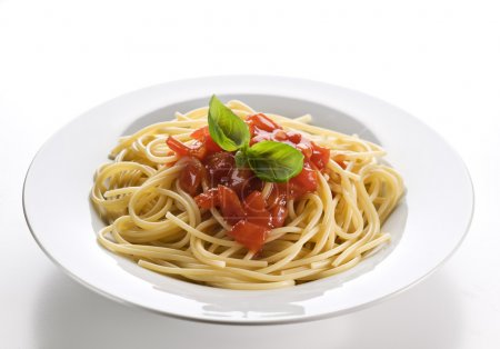 Photo for Spaghetti with tomato sauce and basil close up - Royalty Free Image