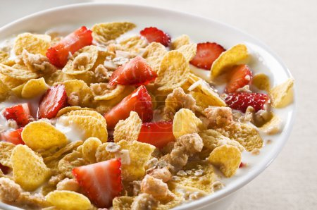 Photo for Fresh corn flakes with strawberries and milk close up - Royalty Free Image