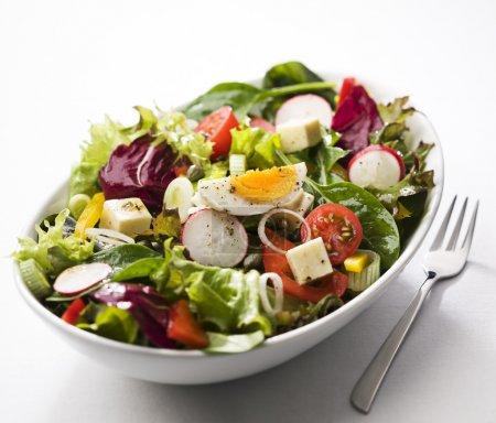 Photo for Fresh mixed salad with egg close up - Royalty Free Image