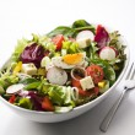 Fresh mixed salad with egg close up...
