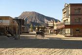 Cowboy driving a wagon at the Mini Hollywood Movie Set