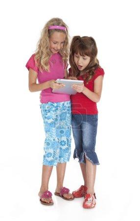 Little Girls Holding Tablet Device
