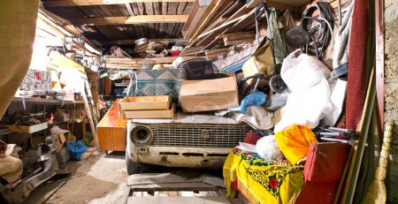 Photo for Garage inside. Old broken car, shelves with tools and stacks of things. - Royalty Free Image