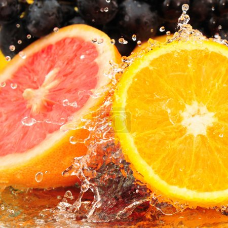Pure fruit in a spray of water isolated on a white...