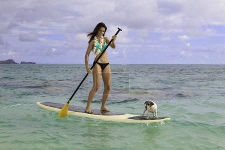 Beautiful woman on her paddle board