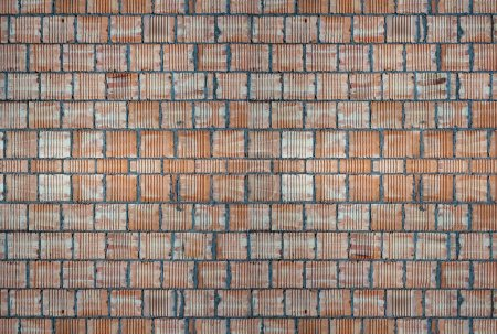 Construction background: red brick wall
