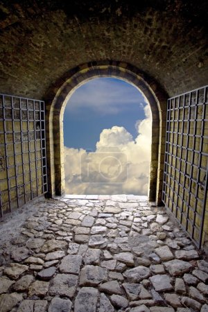 Photo for Old stone tunnel with exit gate like a symbol of hope. - Royalty Free Image