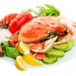 Platter of crab and lobster tails, focus on the cr...