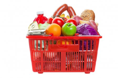 Photo for A shopping basket full of fresh colorful vegetables and fruit isolated on white background - Royalty Free Image