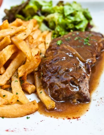 Photo for Juicy steak beef meat with tomato and french fries - Royalty Free Image