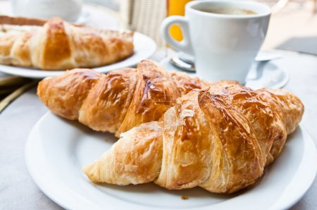 Photo for Breakfast with coffee and croissants in a basket on table - Royalty Free Image