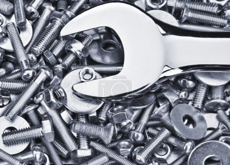 Chrome spanner, nuts and bolts useful as a background