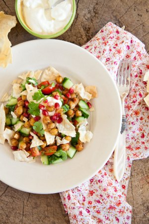 Delicious salad with fresh pomegranate and chickpeas