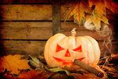 Halloween creepy pumpkin smoking cigar