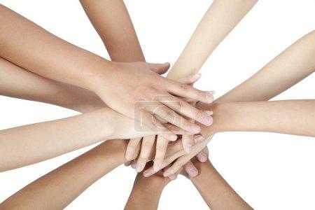 Photo pour Groupe de mains ensemble isolé sur blanc - image libre de droit