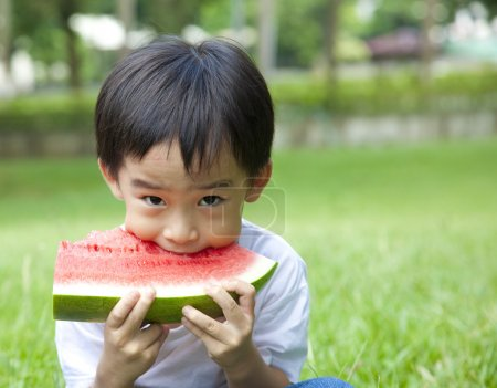 Photo for Boy eating watermelon - Royalty Free Image