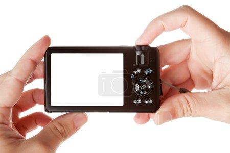Hands holding digital photo camera