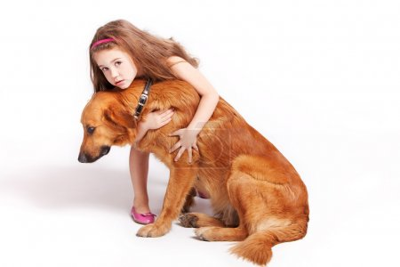 Photo for Little girl with her adopted dog, studio shot - Royalty Free Image
