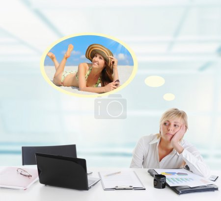 Photo for Tired young blonde woman in the office at the workplace suffers headaches. - Royalty Free Image
