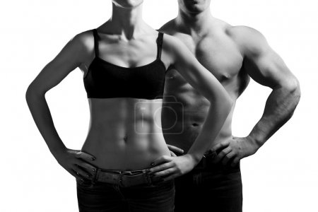 Photo for Bodybuilding. Strong man and a woman posing. Isolated on white background - Royalty Free Image