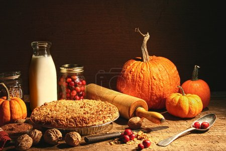Photo for Still life of autumn fruits and and crumble pie on table - Royalty Free Image