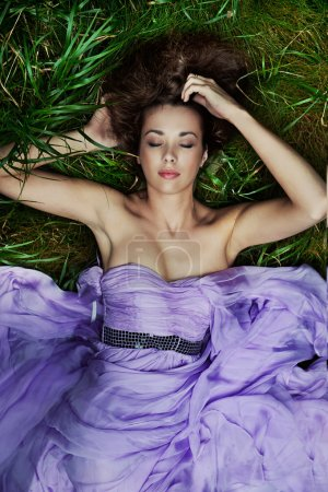 Beautiful woman laying on the grass
