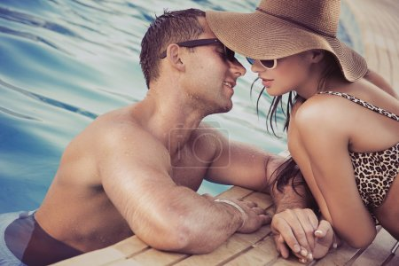 Attractive couple on poolside