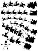 Santa Claus driving in a sledge