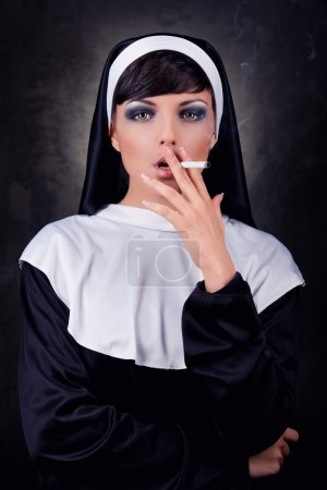 Smoking young nun...