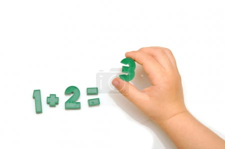 Photo for Number fridge magnets, hand holding the number 3 - Royalty Free Image