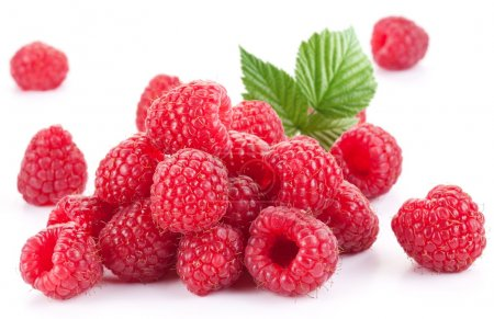 Ripe raspberries isolated on a white background....