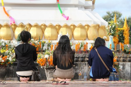 Photo for Women pray to Buddha in the shrine on the bank of Mekong, Vientiane, Laos - Royalty Free Image