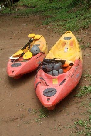 Kayaks near river