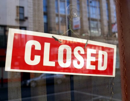 Photo for Closed sign in a shop showroom with reflections - Royalty Free Image