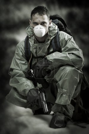 Portrait of person in gas mask. Soldier on war
