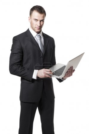 Handsome young businessman in black suit holding notebook